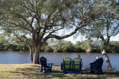 People enjoying the view of the St. Lucie River